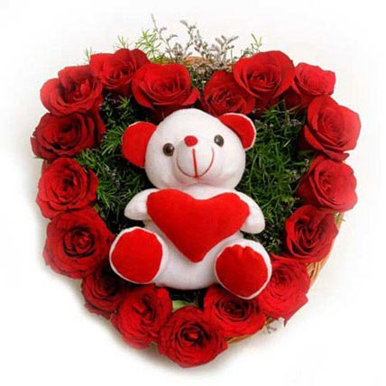 fe5c1c19 A heart shaped 50 red roses with cute teddy bear