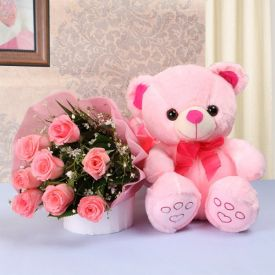 Pink roses with teddy bear