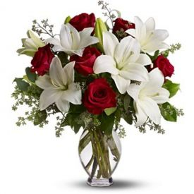 Bunch of red roses and white lilies with vase