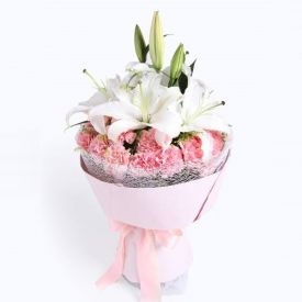 Pink carnation with lilies