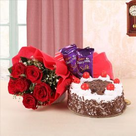 Bunch of red roses, black forest cake and dairy milk