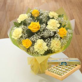 Yellow and White carnation and Sweets