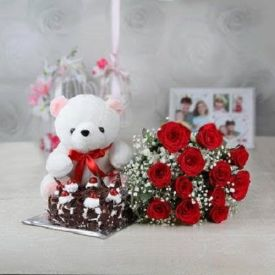 10 Red Roses, 1/2 Black Forest Cake and 6 inch Teddy bear