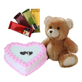 1 Kg heart shaped strawberry cake, 4 Tempatation chocolate and 12 inch teddy bear
