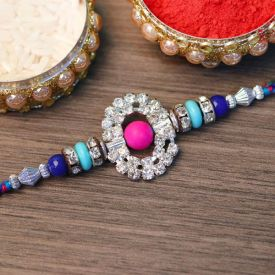 Stone Studded Golden Rakhi