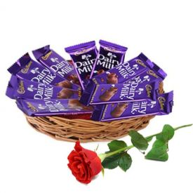 Basket of dairy milk chocolate with red rose