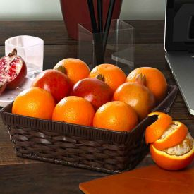 Oranges And Pomegranate in Basket