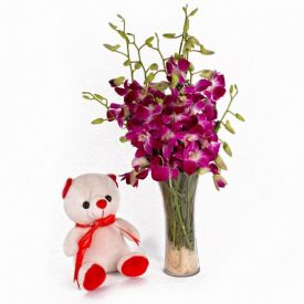 Orchids in vase And Small Teddy bear