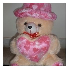 Cute Cap white Teddy bear with little heart