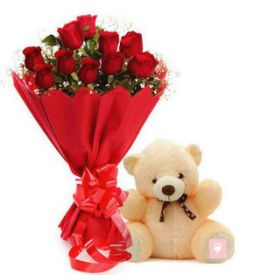 Red roses and cream teddy bear