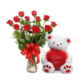 A vase of 20 red rose and a(6 inches) white teddy