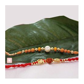 2 Golden Beads and Rudraksha rakhi
