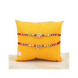 Rakhis with red and golden zari and 2 red stones