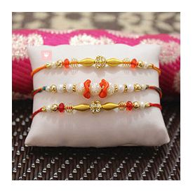 Beautiful Pearl Rakhi along with two Beaded Rakhi