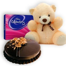 1kg chococlate cake , 12 inch teddy and cadbury celebrations.