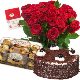 Red roses, black forest cake and ferrero rocher