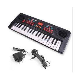 Children kids playing electronic music keyboard