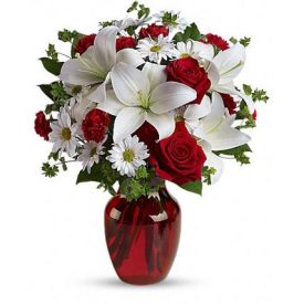 luxurious flowers in classic winter colors. Red roses, snow white lilies and with graceful red gl