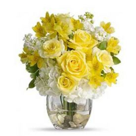 Bouquet of white hydrangea, yellow roses,yellow alstroemeria, with clear glass vase