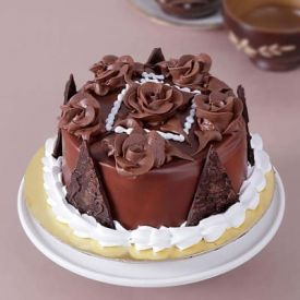 Half Kg Round Chocolate Cake with Chocolate Cream Flowers