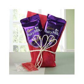 2 Cadbury Chocolate (gift wrapped) with Roli Chawal