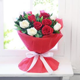 Bunch of 15 red and white roses with paper packing