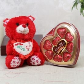 Adorable teddy with heart shape chocolate