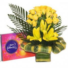 Yellow flowers and chocolates with vase