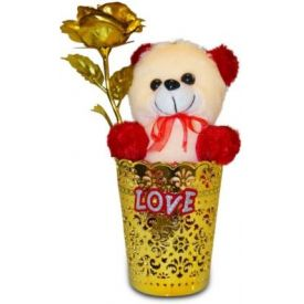 Golden roses in vase with soft toy