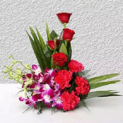 4 Purple Orchids, 4 Dark Pink Carnations, 4 Red Roses