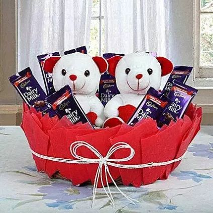 Couple teddy arrangements with chocolates
