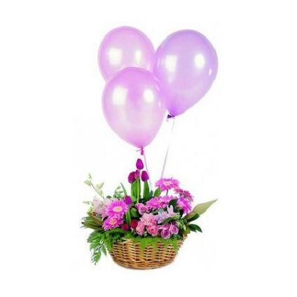A basket of 30 mixed gerberas and 10 balloons