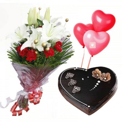 1 kg heart shaped chocolate truffle cake with 7 red carnations, 3 white lilies with balloon