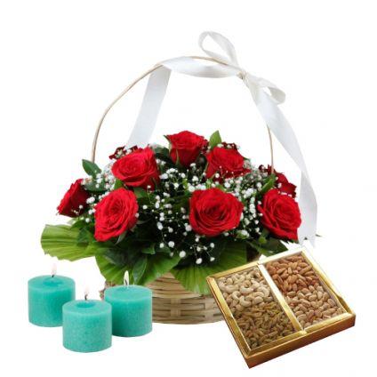 Basket of red roses, dry fruits and diya