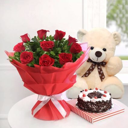 Bunch of 10 red roses 1/2 kg black forest cake and small teddy-bear