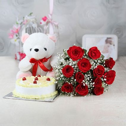 A bunch of 20 red roses 1 kg pineapple cake and white 12- inch- teddy