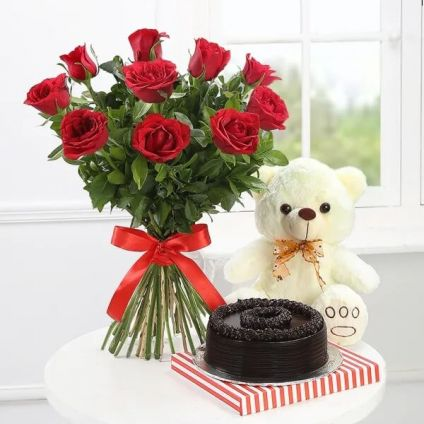 Bunch of 10 Red Roses, 1/2 chocolate Truffle Cake with small teddy