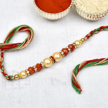 Red and White Pearls Rakhi