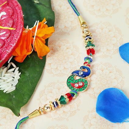 Peacock Rakhi with green red & white stones
