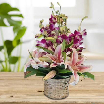 Elegant Floral Arrangement of orchids & lilies