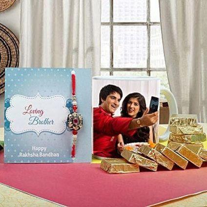 Personalised photo mug, a beautiful rakhi, roli chawal and greeting card
