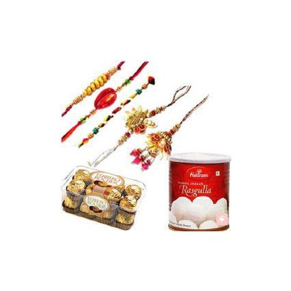 1 Box of Ferrero Rocher Chocolate 16pcs, One box of 1 kg Rasgulla Tin and Five Rakhi