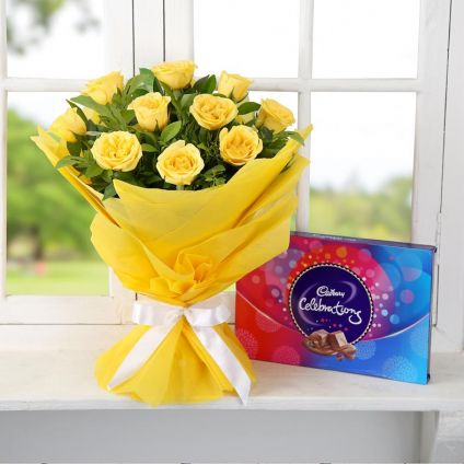 Yellow roses and cadbury celebration