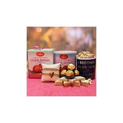 Kaju Katli, Gulab Jamun, Cashews, Ferrero Rocher, printed mug and two beautiful Sandalwood Rakhis