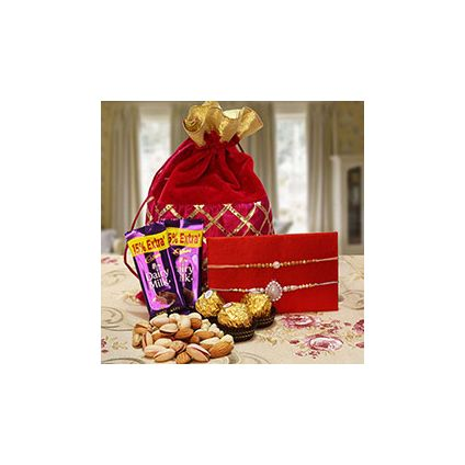 Chocolates to a Designer Potli Bag full of mixed dryfruits Dairy Milk chocolates