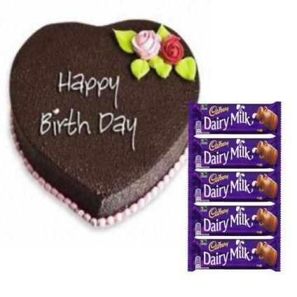 Heart shape cake with chocolates