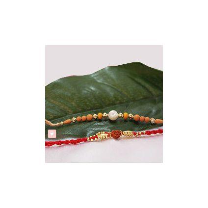 2 Golden Beads and Rudraksha rakhi