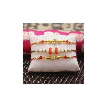 Beautiful Pearl Rakhi along with two Beaded Rakhi