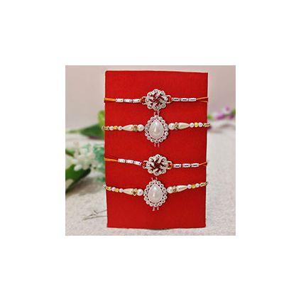 4 Rakhis, 2 Silver Stone Studded Rakhis ,2 Pearl Rakhis
