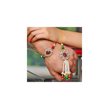 Lumba Rakhi which has maroon stone